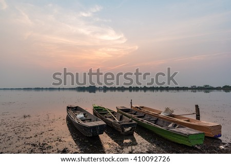small fishing boat on sunset. show filling of south east asia.