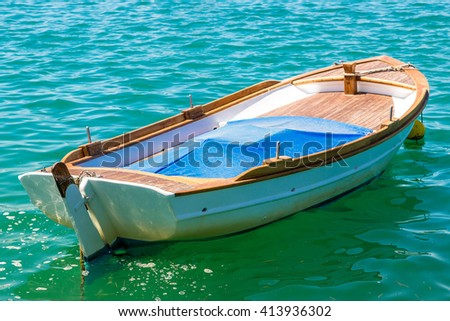 Small fishing boat on the sea in a summer day - stock photo