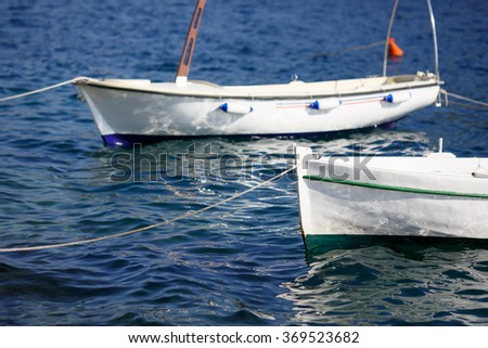 Small fishing boat on the sea water in a sea bay. - stock photo