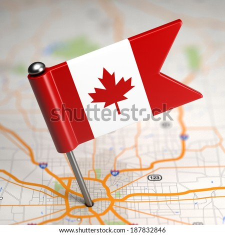 Small Flag of Canada on a Map Background with Selective Focus. - stock photo