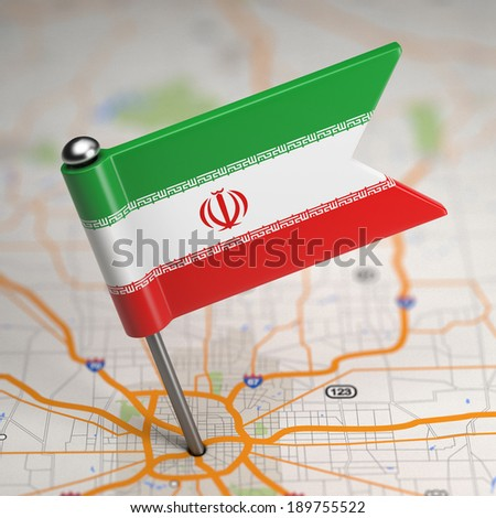 Small Flag of Islamic Republic of Iran on a Map Background with Selective Focus. - stock photo