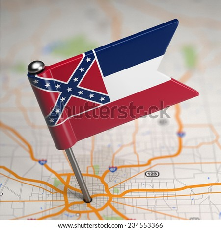 Small Flag of Mississippi on a Map Background with Selective Focus. - stock photo