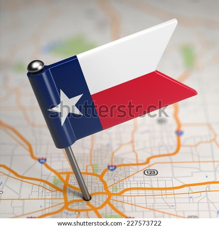 Small Flag of Texas on a Map Background with Selective Focus. - stock photo
