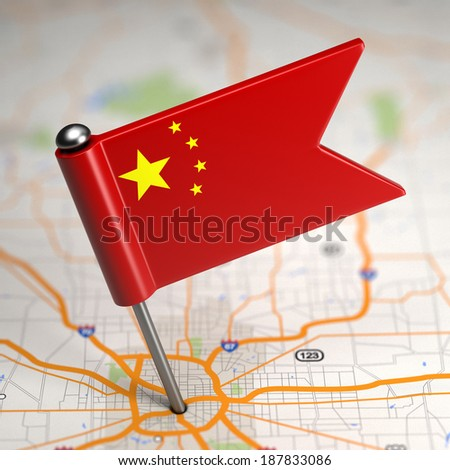 Small Flag of the People's Republic of China on a Map Background with Selective Focus. - stock photo