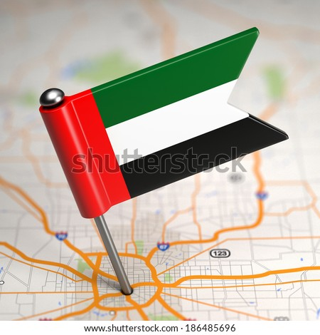 Small Flag of United Arab Emirates Sticked in the Map Background with Selective Focus. - stock photo