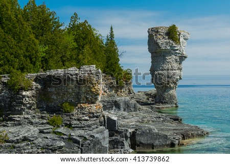 Small flower pot rock formation overlooking the waters of Georgian Bay.