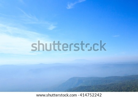 Small fog over the mountain and blue sky and cloud.