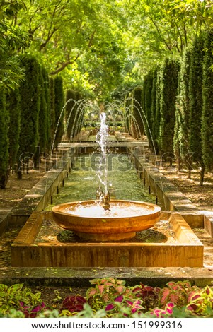 small fountain in a park - stock photo
