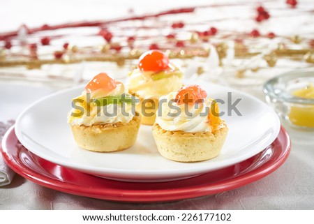 Small fruit tart with vanilla frosting  - stock photo