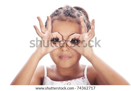 Small funny girl, hands at binoculars - stock photo