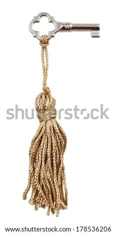 small furniture skeleton key with knot textile trinket isolated on white background - stock photo