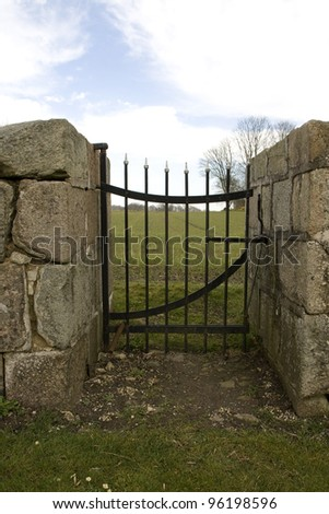 Small gate in a wall made of stone