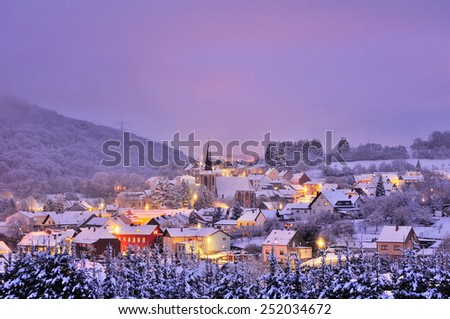 Small german town in a frozen winter night - stock photo