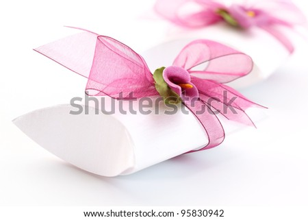 Small gift box decorated with ribbon and flower - stock photo