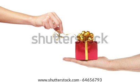 Small gift in palm of hand. Present for woman. Isolated on white
