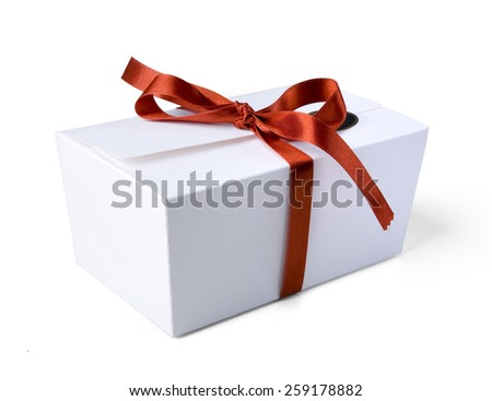 Small giftbox with red ribon - stock photo