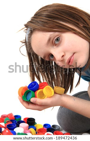 small girl collect plastic caps for recycle  - stock photo