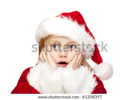 Small girl dressed as santa claus looks surprised.  Isolated on white background. - stock photo