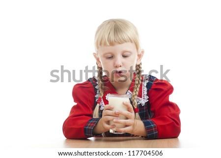 small girl drinking milk - stock photo