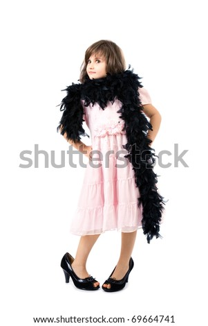 small girl in a high heel shoes and boa - stock photo
