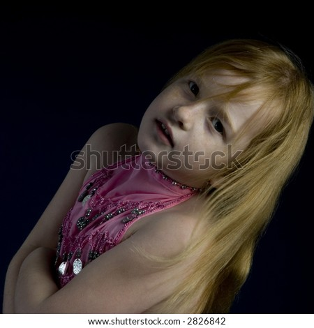 Small girl in the studio - stock photo