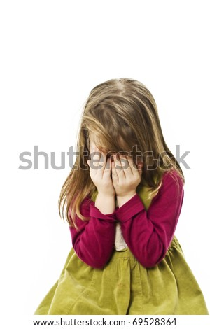 Small girl is covering her face by hands isolated on white - stock photo