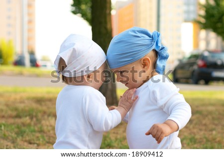 small girl putting her hand on the boy - stock photo
