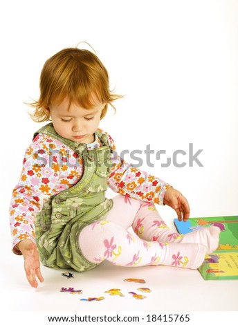 Small girl reads the book