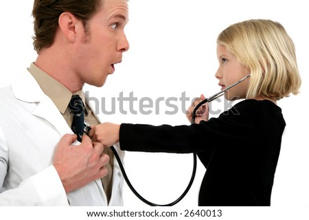 Small girl using stethoscope on doctor - stock photo