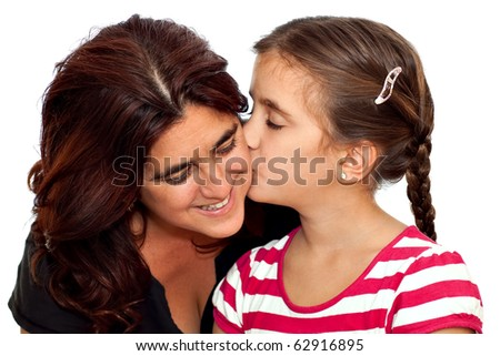 Small girl with braided hair kissing her young latin mother isolated on a white background