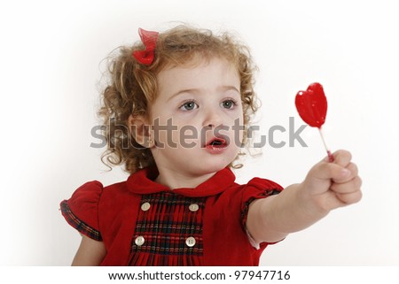 Small girl with candy of stick