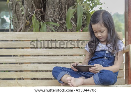 small girl with mobile, asian small girl with mobile,