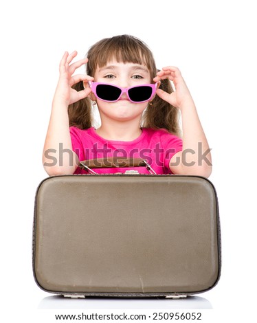 Small girl with sunglasses and suitcase. isolated on white background - stock photo