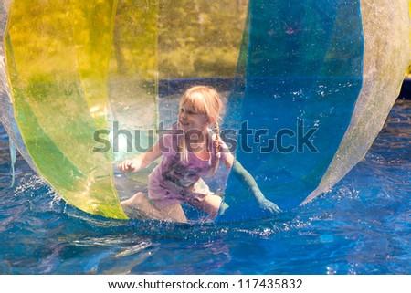 small girl zorbing - stock photo