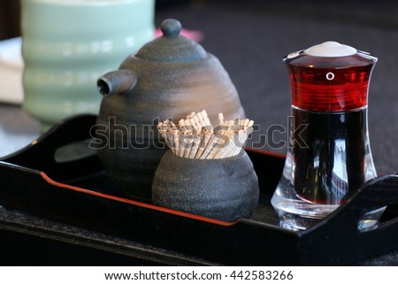 Small glass bottle for sauce Shoyu, cute toothpick in a small ceramics, sets Japanese tableware for customer service - stock photo