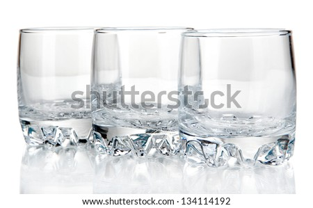 Small glasses for drinks isolated on white - stock photo