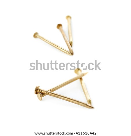 Small golden Pail of Metal nails isolated over the white background - stock photo