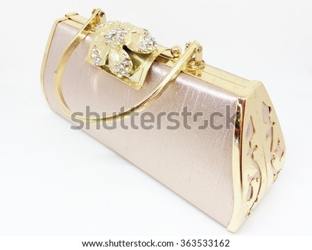 Small golden women handbag isolated on white background