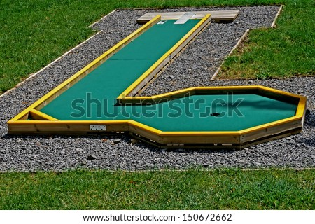 Small golf course built for children in a recreational space. - stock photo