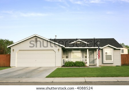 Small gray house with american flag