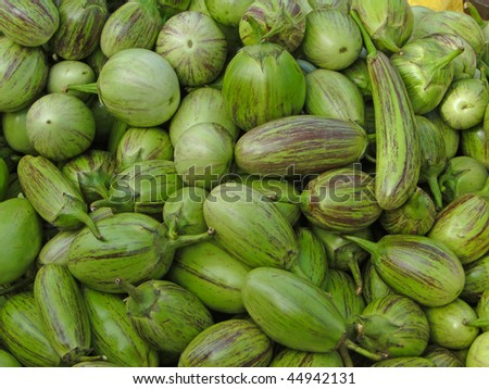 Small, green eggplants at weekly market,   Orissa,  India