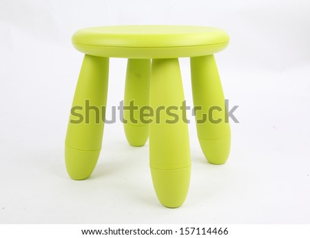 Small green plastic stool for kids isolated on white  - stock photo