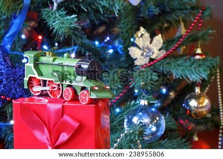 Small green train Christmas gift. Christmas decoration. - stock photo