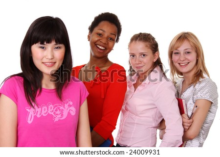Small group - four girls of different nationalities - stock photo