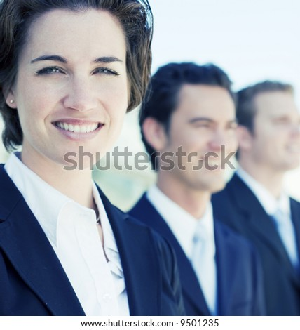 small group of business people in business suits standing looking forward - stock photo