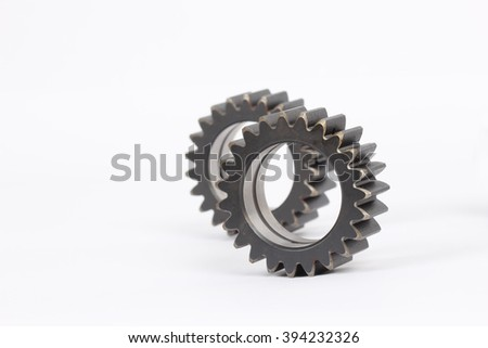 Small group of gears with their teeth engaged on a white background