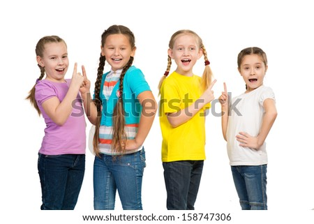 small group of girls stand in a row - stock photo