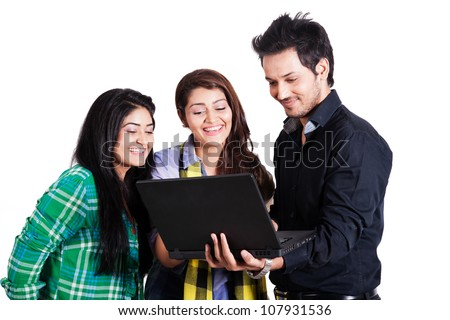 small group of happy friends using laptop, group of happy multi ethnic friends isolated on white - stock photo
