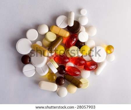 small group of pills on a white background - stock photo