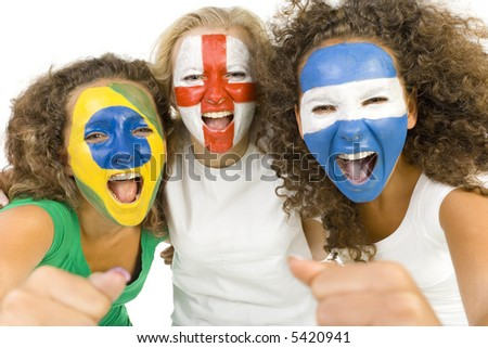 Small group of screaming, international sport's fans with painted flags on faces and with clenched fists. Looking at camera. Front view, white background - stock photo